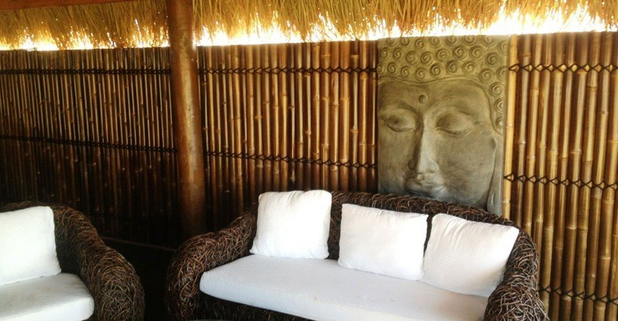 Bamboo Fencing Outdoors Behind White Couch