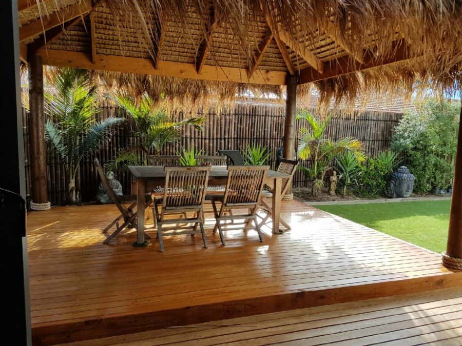 Bali Hut with deck table and chairs and bamboo in yard